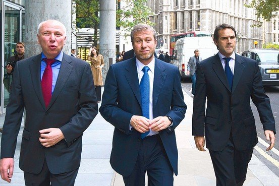 Mr. Abramovich, center, on a break Monday from proceedings in London's commercial court, where he faced the first of several days of questioning. Agence France-Presse/Getty Images